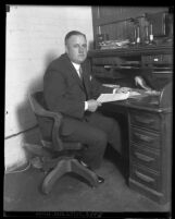 Los Angeles Vice Squad Capt. W.E. Weyerman sitting at his desk,  1929