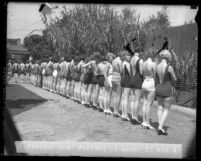 Contestants lined up, side by side, in swim suits, with their backs facing out during National Chiropractic Association's perfect back contest in Los Angeles, Calif., 1927