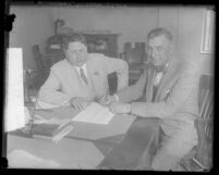 William Wrigley Jr. and Jack Lelivelt signing Lelivelt's contract to become the Los Angeles Angels' manager, Calif., 1929