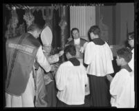 Cardinal James F. McIntyre imposes ashes on foreheads of altar boys in Los Angeles, Calif., 1959