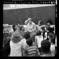 Myra Cohn Livingston, poet-in-residence of Beverly Hills School District, talking with group of students, Calif., 1973