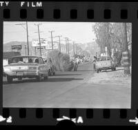 Man removing huge tumbleweed from Lankershim Blvd. in North Hollywood, Calif., 1974