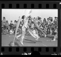 Two girls performing Ribbon Dance marking Chinese New Year at Castelar Elementary School in Los Angeles, Calif., 1974