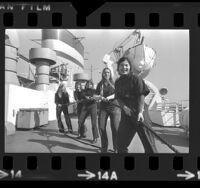 Five women cadets working aboard the California Maritime training ship Golden Bear in Long Beach, Calif., 1974