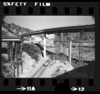 Golden State and Antelope Valley freeway bridges encased by formwork during earthquake repair work at Weldon Canyon south of Santa Clarita, 1973