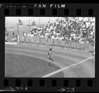 Male streaker running across field during Los Angeles Dodgers game, 1974