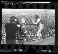 Ozzy Osbourne of Black Sabbath performing before crowd at California Jam concert in Ontario, Calif., 1974