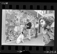 Art therapist Don Dollinger, watching two people paint mural at Beverlywood, an after care center in Los Angeles, Calif., 1974