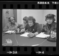 Roscoe Lee Browne, Kate Rickman, Peter Bonerz, and Sally Smaller performing reading of Watergate tapes on KPFK radio in Los Angeles, Calif., 1974