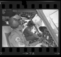 Two Los Angeles County Fire Department helicopter pilots demonstrating their night vision goggles, Calif., 1974