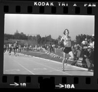 Runner Rick Wohlhuter crossing the finish line at the 86th National Amateur Athletic Union track and field championships in Los Angeles, Calif., 1974