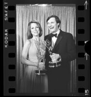 Mary Tyler Moore and Alan Alda holding their Emmy Awards, Calif., 1974