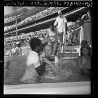 People being baptized during Jehovah's Witnesses convention at Dodger Stadium in Los Angeles, Calif., 1974