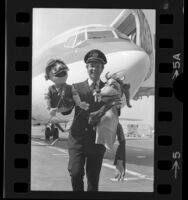 Continental Airlines Pilot Jim Gamble with two of his marionettes, Calif., 1974