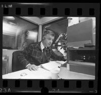 Radio talk show host, Michael Jackson at work in KABC studio in Los Angeles, Calif., 1974