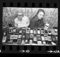 Martha Jordan and Mae Westbrook displaying an array of pocket calculators from their store, Electronic Emporium, in West Hollywood, Calif., 1974