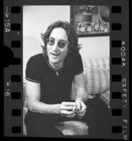 John Lennon being interviewed in Los Angeles, Calif., 1974