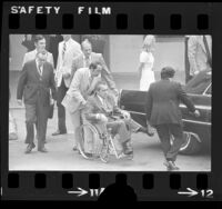 Richard M. Nixon leaving hospital in wheelchair after treatment for phlebitis in Long Beach, Calif., 1974