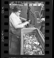 """Western Badge & Trophy Company employee making """"WIN"""" (Whip Inflation Now) buttons in Los Angeles, Calif., 1974"""