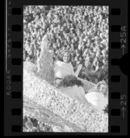 Rose Queen, Robin Carr riding on float in Tournament of Roses parade in Pasadena, Calif., 1975