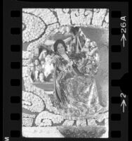 Woman waving to crowd from float entered by Mexico in the Tournament of Roses parade in Pasadena, Calif., 1975
