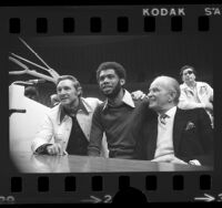 Bill Sharman, Kareem Abdul-Jabbar and Jack Kent Cooke at press conference announcing Lakers' signing Kareem in Los Angeles, Calif., 1975