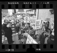 Leonard Levy and garment workers picketing against clothing imports at 8th and Broadway in Los Angeles, Calif., 1974