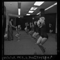 Bikram Choudhary conducting Hatha yoga class, pretzel pose, in Los Angeles, Calif., 1974