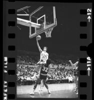 USC's John Lambert going up for a basket as Oregon's Stu Jackson watches during game in Los Angeles, Calif., 1975