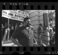 Former L.A. Rams player, Roosevelt Grier speaking against school busing cutback in Pasadena, Calif., 1974
