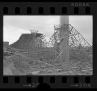 Collapsed scaffolding surrounding columns during construction of Simi Valley-San Fernando Valley Freeway, Simi Valley, 1974