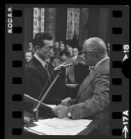 Hiroo Onada with councilman Gilbert Lindsay in the City Council Chamber in City Hall, Los Angeles, Calif., 1975