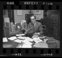 Librarian Daniel Woodward seated in office at Huntington Library in San Marino, Calif., 1975