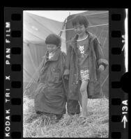Two Vietnamese boys wearing marine jackets at refugee camp at Camp Pendleton, Calif., 1975