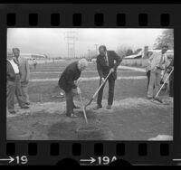 Mayor Tom Bradley and actor Eddie Albert tilling soil at dedication of community garden in Reseda, Calif., 1975