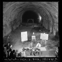 Tom Bradley and Baxter Ward holding press conference in old Pacific Electric Tunnel to propose rail system plan in Los Angeles, Calif., 1975