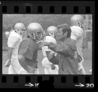 UCLA football coach, Dick Vermeil talking with player during practice in Los Angeles, Calif., 1975