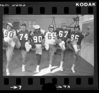 Six Los Angeles Rams players performing a kick line dance, Calif., 1975