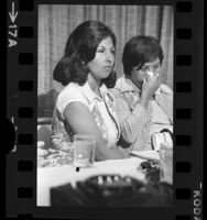 Gloria Molina and Dolores Madrigal holding news conference announcing class action suit against hospital in Los Angeles, Calif., 1975