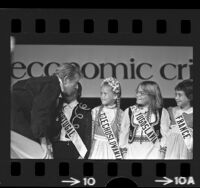 Entertainer Danny Kaye talking with members of the International Children's Choir in Los Angeles, Calif., 1975