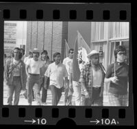 Cesar Chavez on march from Mexican border to Sacramento with United Farm Workers members in Redondo Beach, Calif., 1975