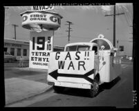 "Gas station with sign reading ""Gasoline War"" at 3rd Avenue and Beverly in Los Angeles, Calif., 1954"
