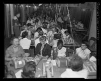 Corridor filled with men and women tabulating ballots for California primary election in Los Angeles, Calif., 1954