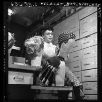 Woman wigmaker at Max Factor in Los Angeles, Calif., circa 1954
