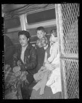 Illegal Mexican immigrant roundup couple with children in Los Angeles, 1954