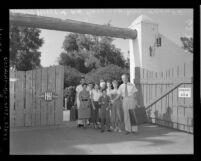 "Horace Heidt with members of his ""The American Way"" troupe at gate of Double HH Ranch in Calif., 1954"