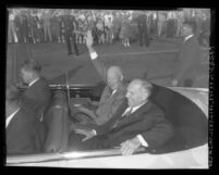 Dwight Eisenhower and Goodwin Jess Knight riding in motorcade in Los Angeles, Calif., 1954