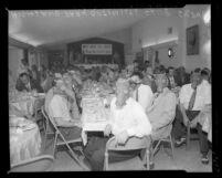 Highland Park Optimist Club wearing smog-gas masks at banquet, Los Angeles, Calif., circa 1954