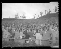 New U.S. citizens take oath of allegiance in mass ceremony at Hollywood Bowl, Calif., 1954