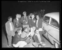Teenagers arrested for hot rod racing on Artesia St. in South Compton, Calif., 1954
